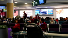 People waiting for their friend at international arrival lobby resting area Stock Footage