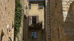 Medieval street with stone buildings in Tourrettes-sur-Loup Stock Footage