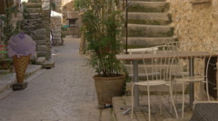 Tom's famous violet flavour ice cream on Grand Rue street in Tourrettes-sur-Loup Stock Footage