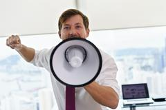 White Collar Worker With Megaphone Fighting For Labor Rights Stock Photos
