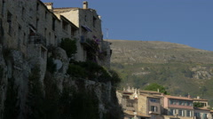 Stone buildings, trees and bushes in Tourrettes-sur-Loup Stock Footage