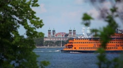Staten Island Ferry Sails Along Governors Island Stock Footage