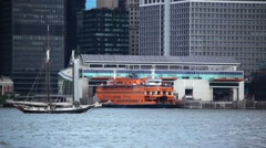 Sailboat Passes Staten Island Ferry In NYC - stock footage