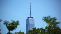 Rising From The Trees Is World Trade Center One Stock Footage
