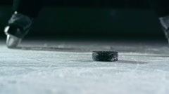 Shooting a Hockey Puck Stock Footage