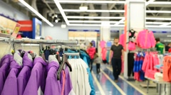 Interior of  clothing store and going customers - stock footage