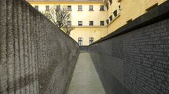 Names of dead prisoners on a wall at Sighet Memorial Museum - stock footage