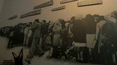 Poster of people staying in line at the grocery store at Sighet Memorial Museum Stock Footage