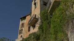 Low angle view of stone buildings in Tourrettes-sur-Loup Stock Footage