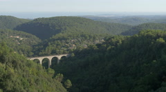 A Roman bridge over a viaduct seen from Tourrettes-sur-Loup Stock Footage