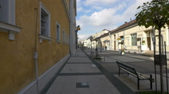 People walking on Corneliu Coposu street near Sighet Memorial Museum Stock Footage