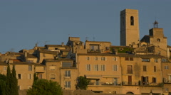 The tower and buildings of Tourrettes-sur-Loup seen at sunset Stock Footage