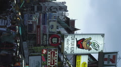 Vertical View of Advertising Signs on Buildings in Khao San Road Stock Footage