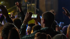 Spectators shooting video of a music concert performance via smart phone came Stock Footage
