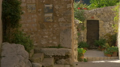 Buildings with stone walls and flowers in Tourrettes-sur-Loup Stock Footage