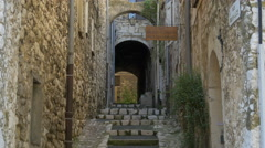 Rue Sainte-Luce with stone walls and stairs in Vence, France Stock Footage