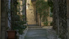 Stock Video Footage of View of a street with stone walls and green plants in Vence, France