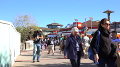 People walking on boardwalk. - stock footage