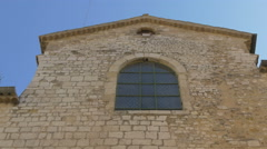 Low angle view of a stone building in Vence - stock footage
