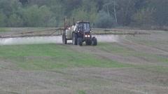 Sprayer machine spray farm field weeds with herbicides in autumn. 4K Stock Footage