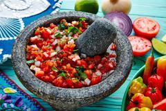 Pico de Gallo sauce from Mexico in molcajete - stock photo