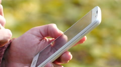 Closeup fingers sliding smart phone touch screen display in news feed facebook - stock footage