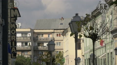 View of the Memorial sign, lamp posts and buildings near Sighet Memorial Museum Stock Footage