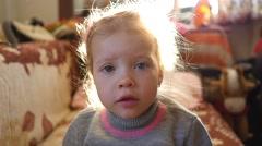 Little kid girl upset look grimace portrait Stock Footage