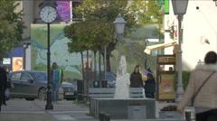 People walking on  Corneliu Coposu street close to Sighet Memorial Museum Stock Footage