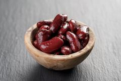 red beans from can in wood bowl - stock photo