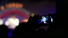 Spectator take a video via smartphone camera of a concert performance - stock footage