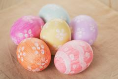 handpainted easter eggs on table - stock photo