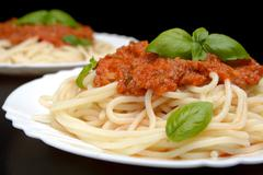 Close up pasta with ragu alla bolognese sauce on black - stock photo