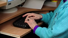 Old woman near computer Stock Footage