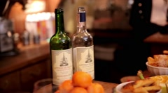Two bottles of wine and appetizer - stock footage