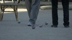 Men playing jeu de boules in Vence Stock Footage