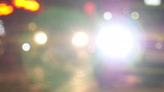 Night traffic taxi car defocus headlights and pedestrians - stock footage