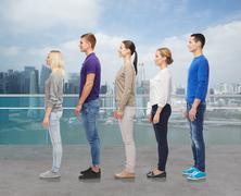 group of people over city waterside background - stock photo