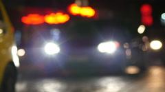 Night traffic taxi car headlights and pedestrians in Sofia Bulgaria - stock footage