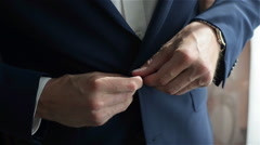 Man dressing dark blue suit Stock Footage