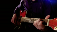 Man playing an acoustic guitar. - stock footage