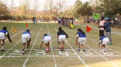 Young girls running on track lane - stock footage