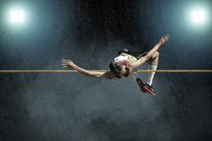 Athlete in action of high jump. Stock Photos