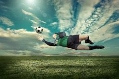 Stock Photo of Soccer player with ball in action outdoors.
