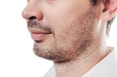 Bristle on a face at the man - stock photo