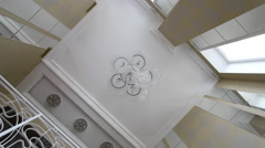 A large crystal chandelier on the ceiling. Arkistovideo