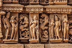 Sculptures on Adinath Jain Temple, Khajuraho - stock photo