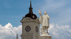 Monument to explorer Christopher Columbus and tower with watch on the Columbus Stock Footage