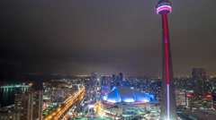 Night time time lapse of CN tower and Rogers Centre in Toronto Stock Footage