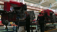 Gomel, Belarus, May 5, 2015: Workers collect Agricultural machinery at factory - stock footage